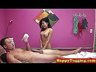 Oriental masseuse tugging client during massage