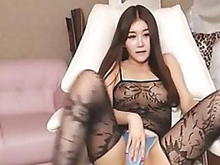 Pretty korean camgirl in fishnet bodysuit